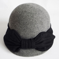 grey hat with a bow